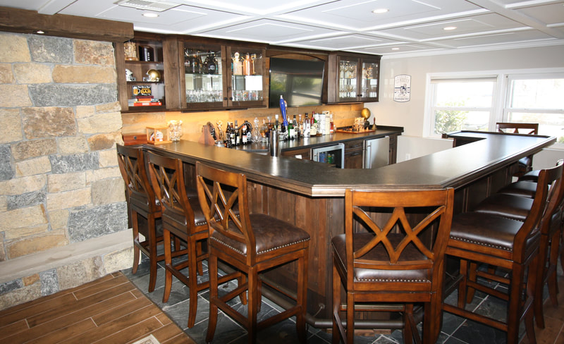 Custom Bar makes great use of basement space! Montville, NJ This beautiful Rustic Alder wood with slate floor and wood-like ceramic tile is a hit!